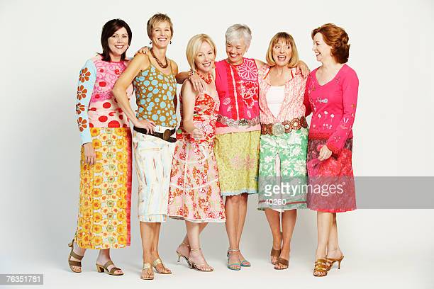 group of mature women standing together - older women in short skirts stock pictures, royalty-free photos & images