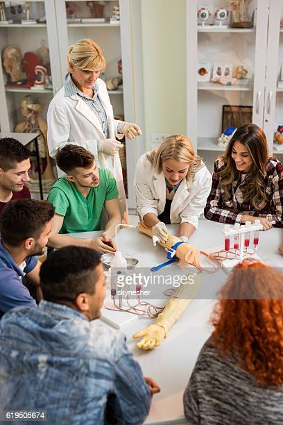 Group of medical students during training class in laboratory.