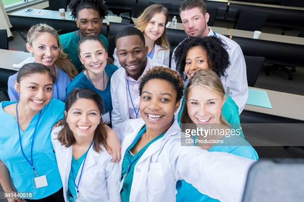 group of medical students take selfie in classroom - community college stock pictures, royalty-free photos & images