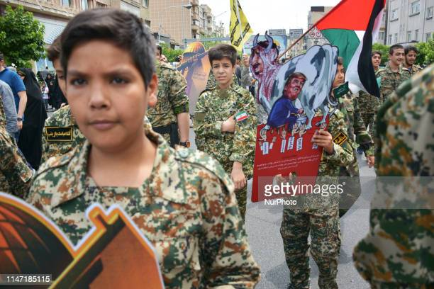 Group of members of Basij paramilitary force, affiliated to the Revolutionary Guard, chant slogan during the annual Quds, or Jerusalem Day rally in...