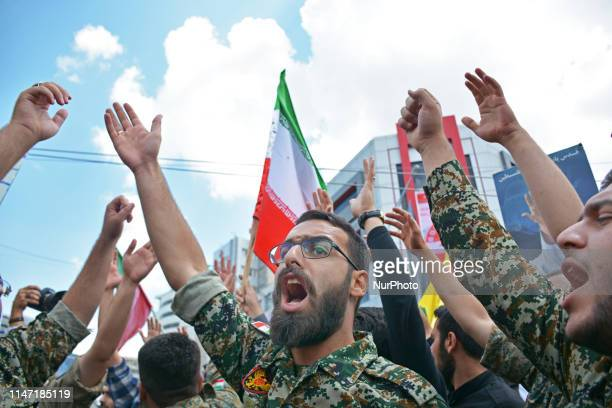 A group of members of Basij paramilitary force affiliated to the Revolutionary Guard chant slogan during the annual Quds or Jerusalem Day rally in...