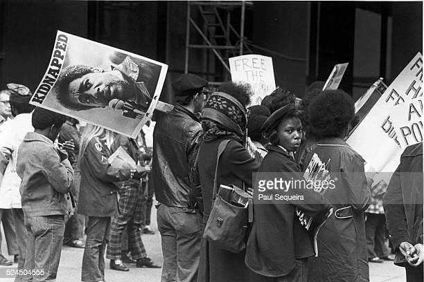 A group of men and women gather outside the Dirksen Federal Building to rally for the release of Black Panther Party cofounder Bobby Seale Chicago...