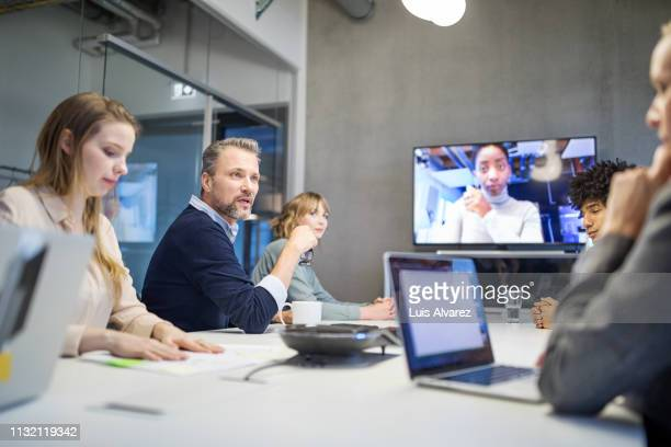 group of men and women having meeting at office - conference call stock pictures, royalty-free photos & images