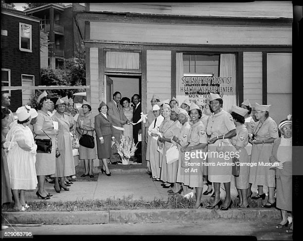 Group of men and women most wearing service uniforms including left side Louise Davis Ellen Allesberry Win Thomas G Woods E Washington Marjorie...