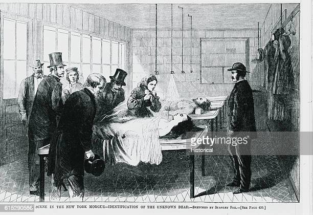 A group of men and women stand around a table to identify a unknown body in a New York City morgue