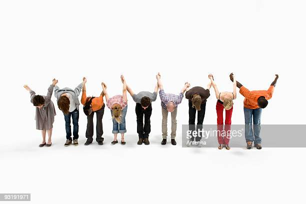 a group of men and women taking a bow together - actress stock pictures, royalty-free photos & images