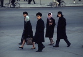 Group of men and women walking down a street in a north korean city picture id112765967?s=170x170