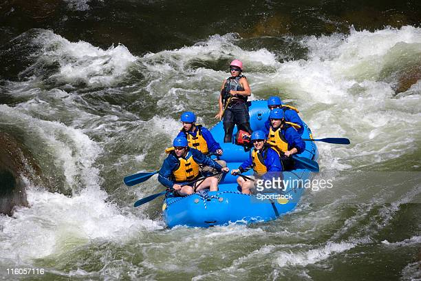 Group of Men and Women White Water Rafting