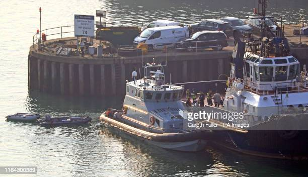 A group of men are brought to shore by Border Force officers at the Port of Dover Kent after they intercepted dinghies containing suspected migrants...