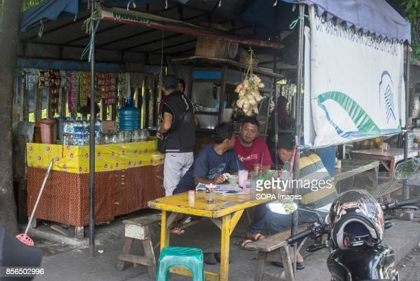 A 'WARKOP' IN SURABAYA EAST JAVA SURABAYA INDONESIA A group of men are seen drinking a coffee in a Warkop 'Warkop' is the name of Indonesia small...