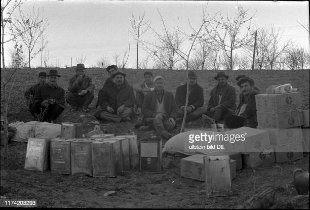 A group of men behind aid supplies Earthquake in Gediz Turkey 1970