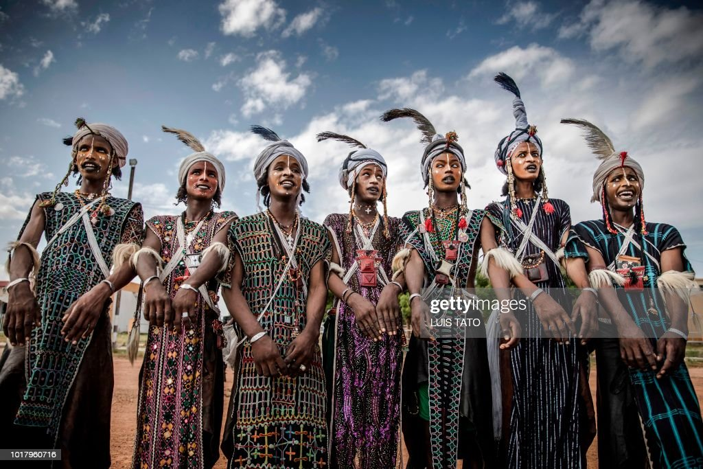 a group of men belonging to the fulani tribe from niger perform a