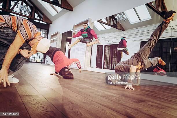 Group of men breakdancing indoors