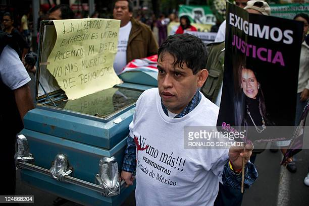 A group of men carry a coffin during a protest against violence towards journalists in Mexico on September 11 in Mexico City More than 60 journalists...