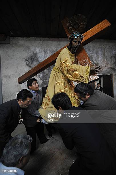 A group of men carry the effigy of Jesus Nazareno de la Dulce Mirada on November 17 2009 after being restored and before being taken to its church in...