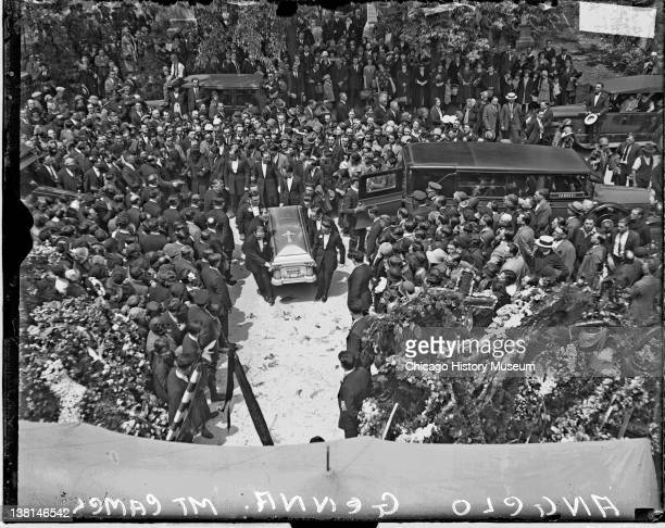 Group of men carrying the casket of reputed Chicago gangster Angelo Genna on a pathway at Mount Carmel Cemetery Chicago Illinois May 1 1925