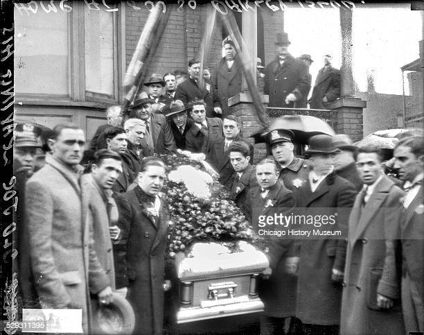 Group of men carrying the casket of reputed Chicago gangster Joseph Esposito down the steps in front of Esposito's home located at 800 South Oakley...