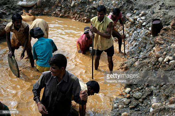 A group of men collecting stones from the bank of Dauki River in Sylhet Bangladesh January 19 2010 The river coming from the Himalaya Mountains in...