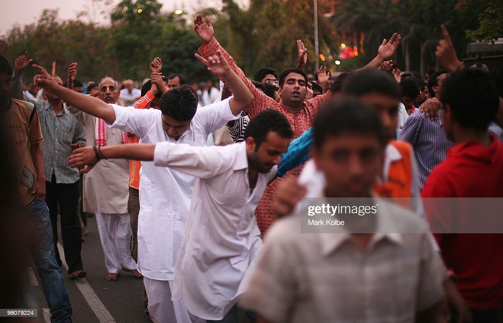 A group of men dance as locals of Chandigarh take to the street as they celebrate Ram Navmi religious festival on March 25 2010 in Chandigarh India...