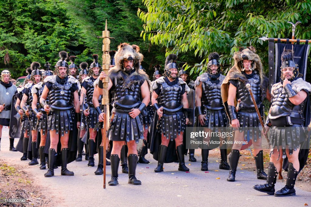 Group of men disguised as Roman legionaries during the Arde Lvcvs festival in Lugo, Galicia, Spain : Stock Photo