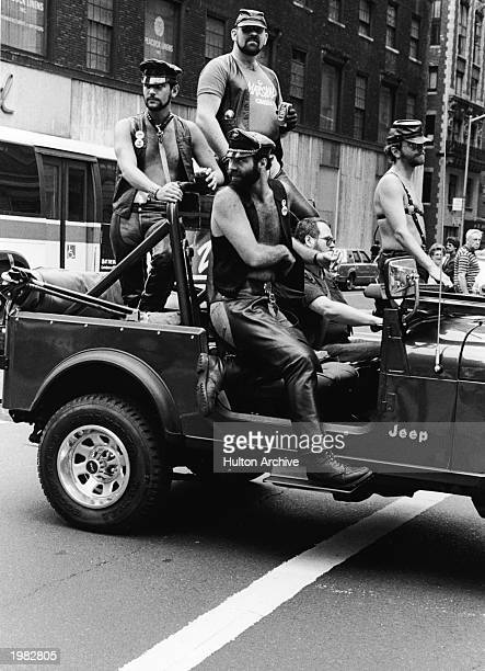A group of men dressed in leather fetish clothing ride in a truck at the intersection of 32nd Street and Fifth Avenue during the annual Gay Pride...