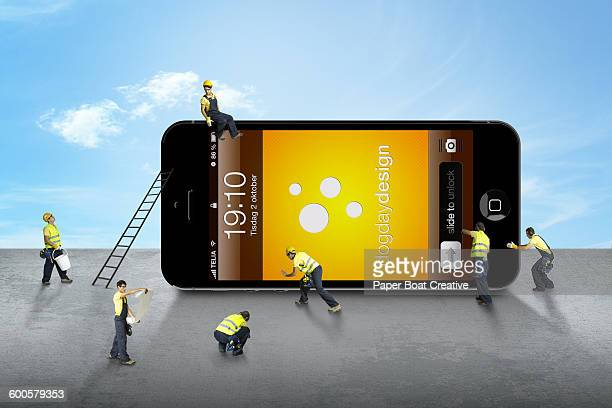 group of men fixing a mobile phone