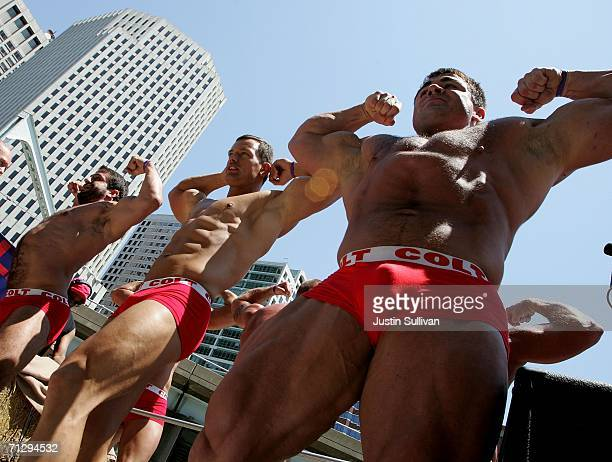 Group of men flex their muscles as the participate in the 36th annual LGBT Pride Parade June 25, 2006 in San Francisco. Hundreds of thousands of...