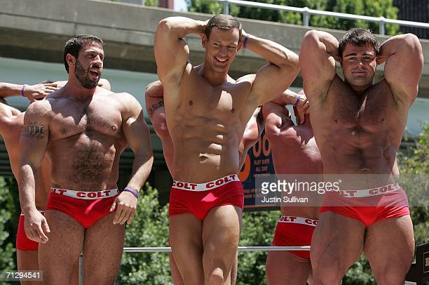 A group of men flex their muscles as the participate in the 36th annual LGBT Pride Parade June 25 2006 in San Francisco Hundreds of thousands of...