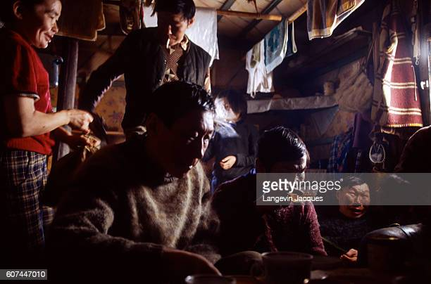 A group of men from a Dolgan hunting party rest after returning to their camp near the village of Syndassko Russia The Dolgans traditionally a...