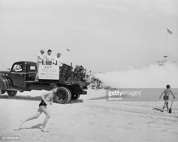 A group of men from Todd Shipyards Corporation run their first public test of an insecticidal fogging machine at Jones Beach in New York As part of...