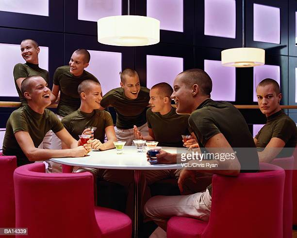 group of men having drinks (digital composite) - cloning stock pictures, royalty-free photos & images