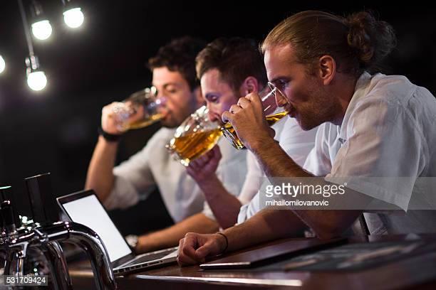 Group of men having fun at the bar