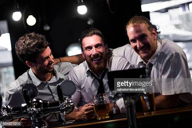 Group of men having fun in a pub