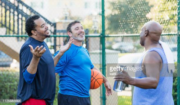 group of men having fun on basketball court - only mature men stock pictures, royalty-free photos & images
