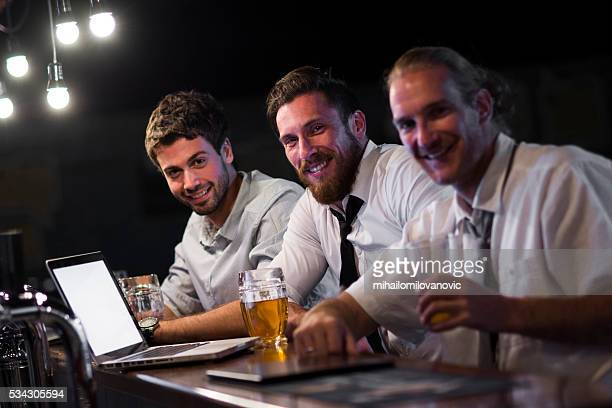 Group of men in a bar