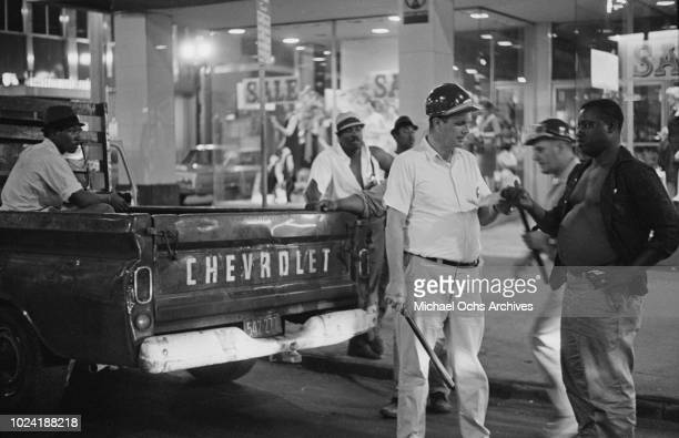 A group of men in a Chevrolet during the 1964 Rochester race riot in Rochester New York State 25th26th July 1964