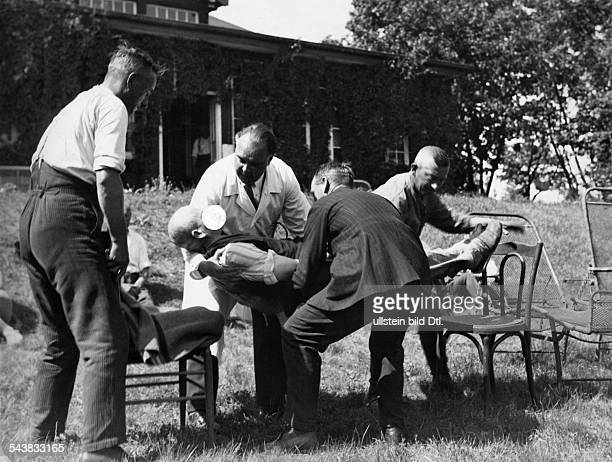 A group of men in presence of a doctor lying a hypnotised man on chairs 1930 Photographer Weltrundschau Neudin Published by 'BZ' 26/1930Vintage...