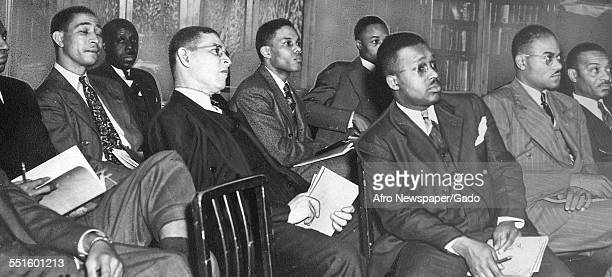 A group of men in suits seated at a meeting in the Afro American newspaper offices Baltimore Maryland 1948