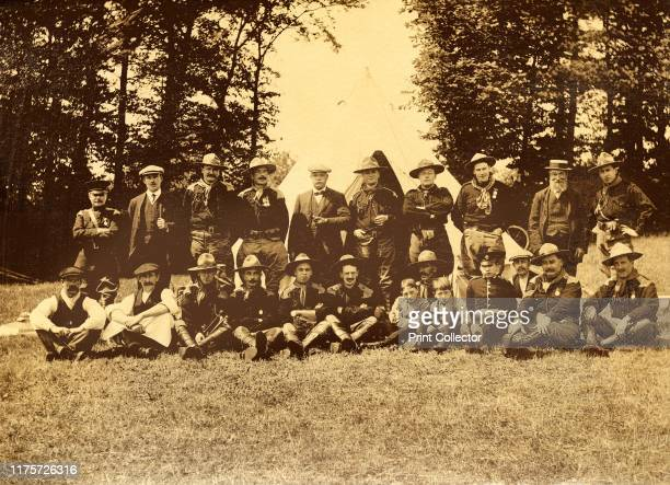 Group of men in uniform in front of a tipi Buckinghamshire 1913 Group portrait of scout leaders with chainmail epaulettes British soldiers on active...