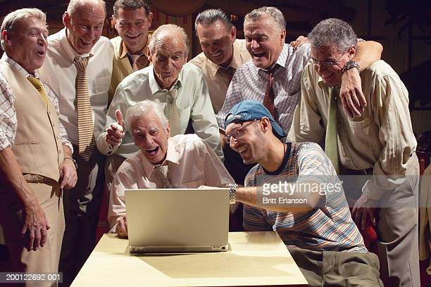 group of men laughing at laptop - x rated stock pictures, royalty-free photos & images