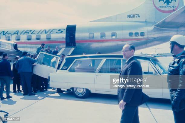 A group of men move the late Dr Martin Luther King Jr's casket from a hearse to the loading ramp of an American Airlines plane on the tarmac at...