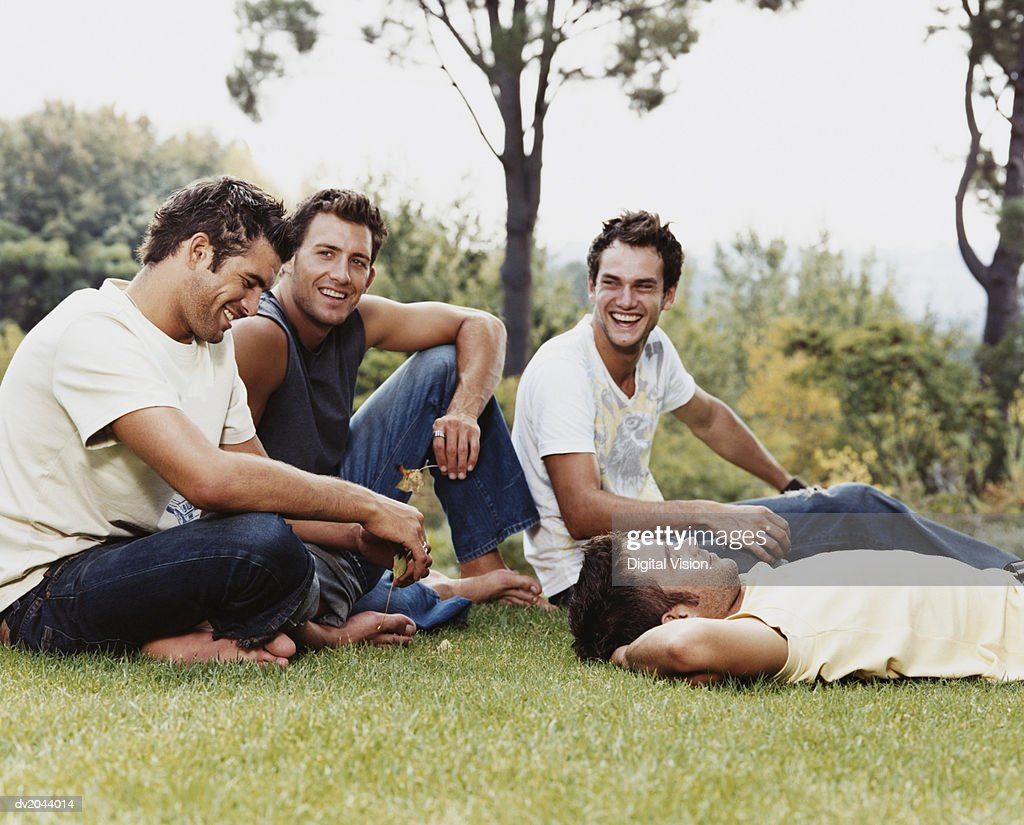 Group of Men on Grass in a Park : Stock Photo