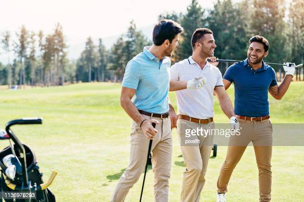 group of men on the golf course - golfer stock pictures, royalty-free photos & images