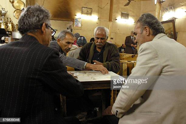 A group of men play a game at the Sharia Raschid cafe At the Sharia Raschid cafe poets writers and journalists meet to exchange materials ideas and...