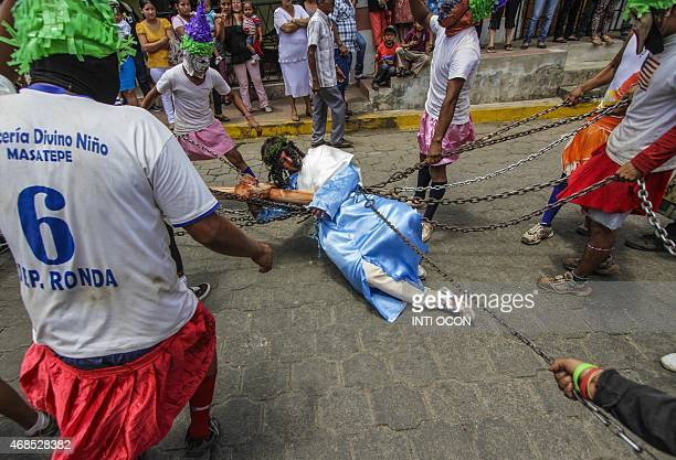 A group of men play the Jews of Masatepe during the procession ''The chained'' in which residents chase and capture other people dressed as Judas to...