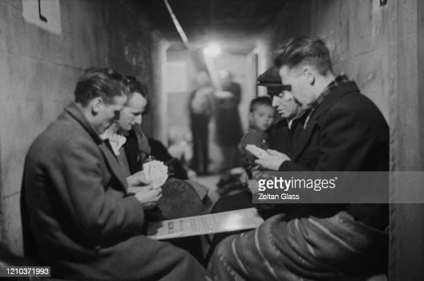 A group of men playing cards in an air raid shelter during the Blitz London October 1940 Original Publication Picture Post 308 Shelter Life pub 26th...