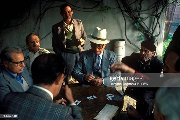 A group of men playing cards Turin circa 1975