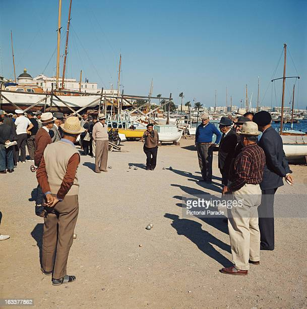 A group of men playing petanque in Cannes France circa 1970