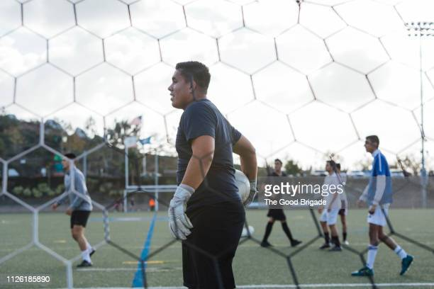 group of men playing pick up soccer game - goalkeeper stock pictures, royalty-free photos & images