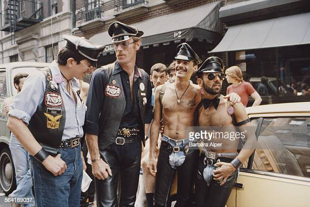 A group of men relax on the street during the Gay Pride parade in New York City USA June 1982